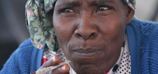 nama woman smoking in kalahari desert