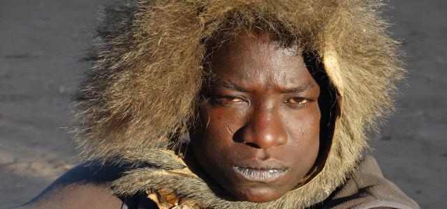 hadzabe man in tanzania with a cap made with fur