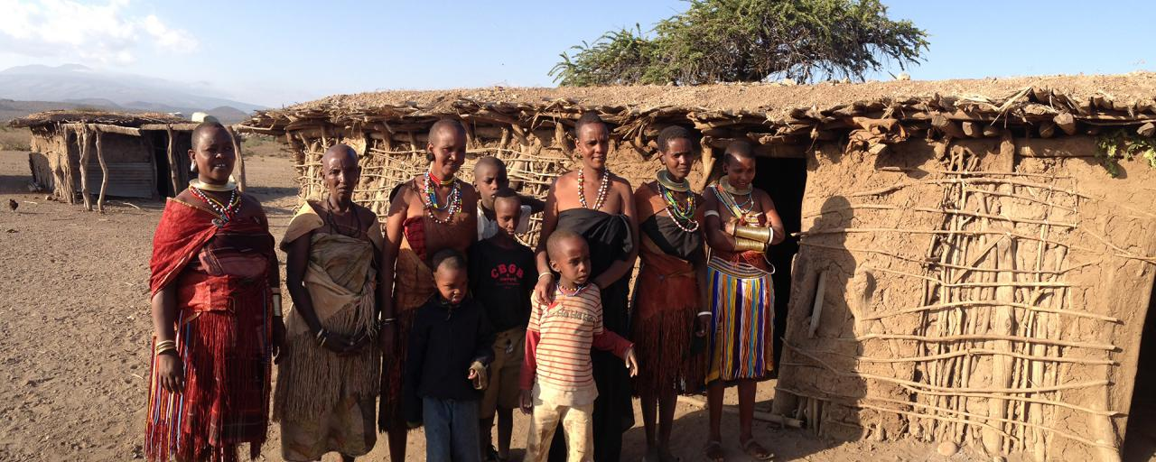 datoga people in front of their huts in tanzania