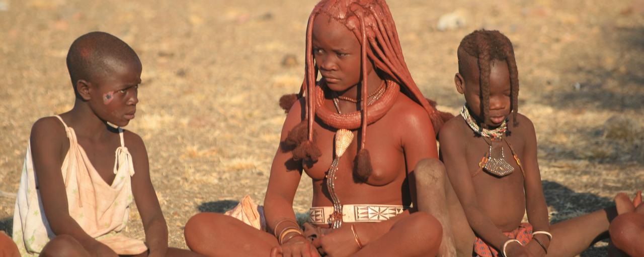 Himba girl and boys at the village