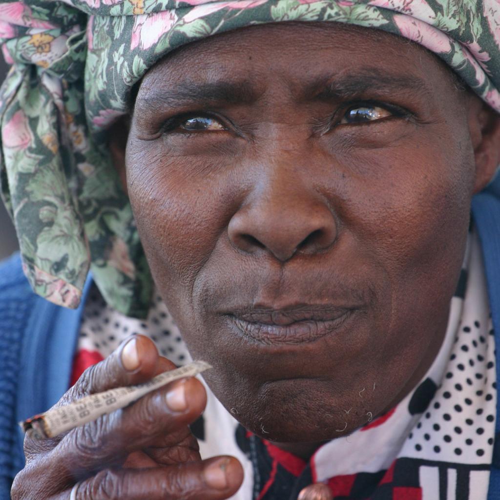 nama woman smoking in kalahari desert