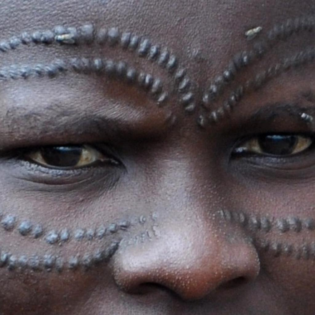 datoga woman with traditional scarification in tanzania