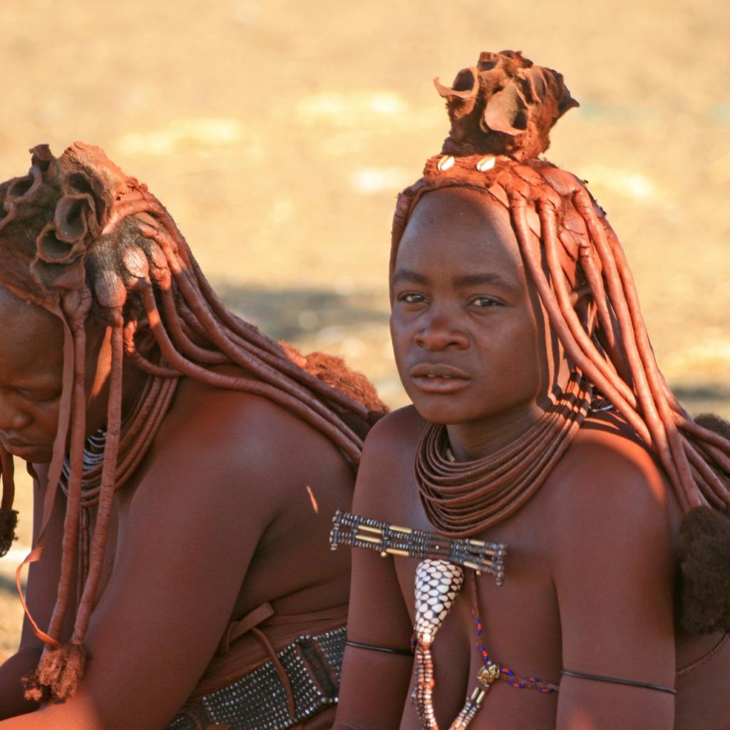 him women with red skin and beautiful hairstyle him namibia