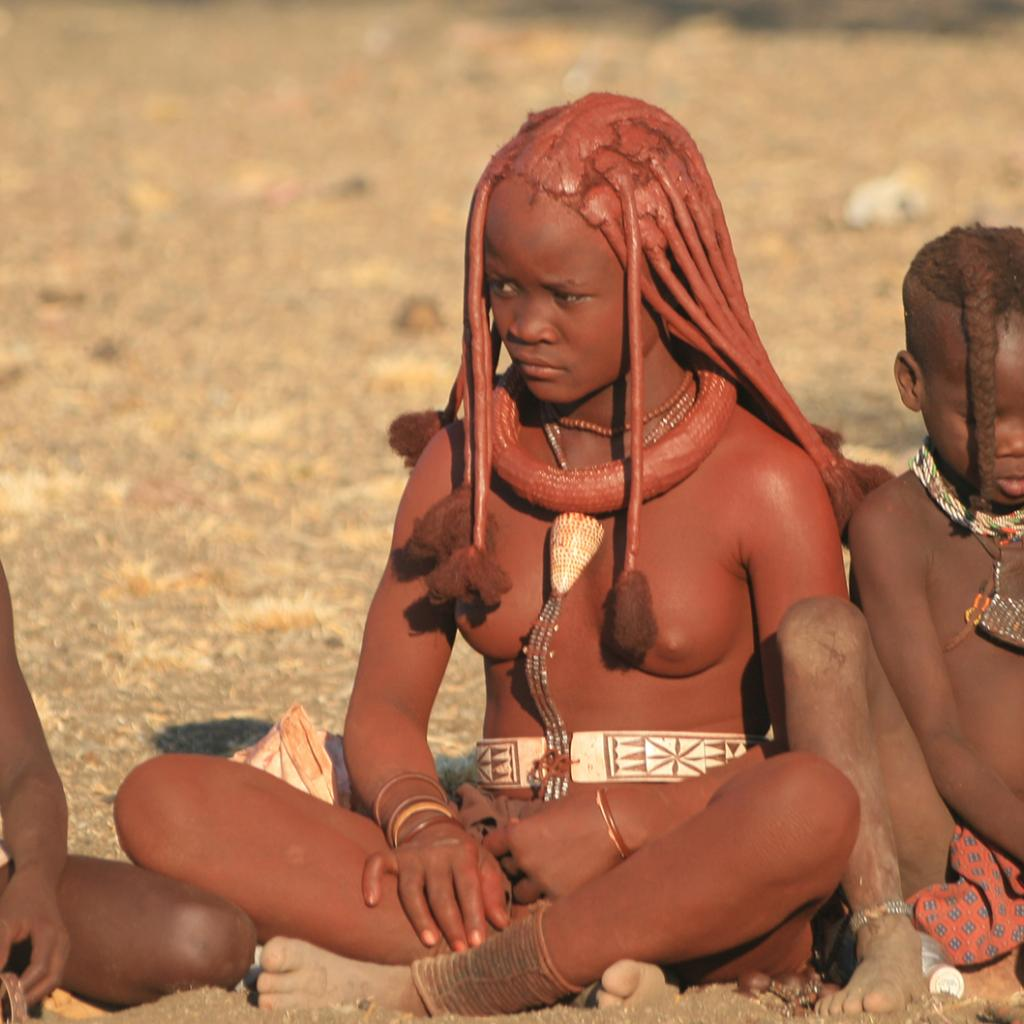 Himba girl and boys at the village